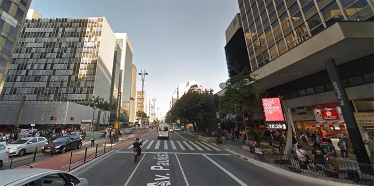 Foto do bairro Jardim Paulista, com a Av Paulista em destaque ao centro e prédios comerciais dos dois lados